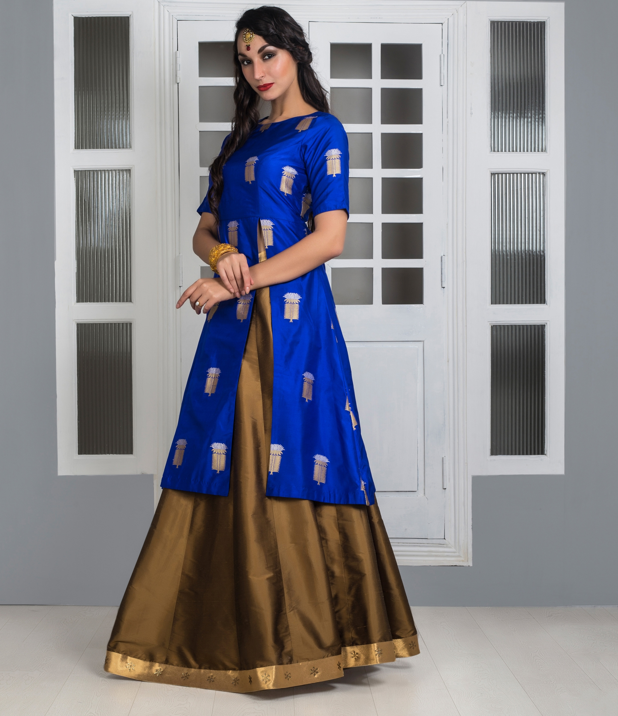 baba2ad26bc ... Lehengas · The Banaras Story · Royal blue and gold long top silk Lehenga.  1